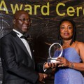 Felicia Twumasi receiving the Ernst & Young Award